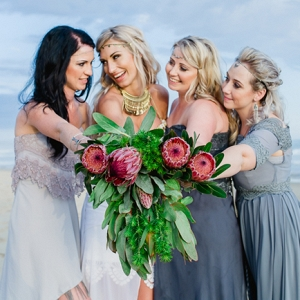Bridesmaids with protea bouquets