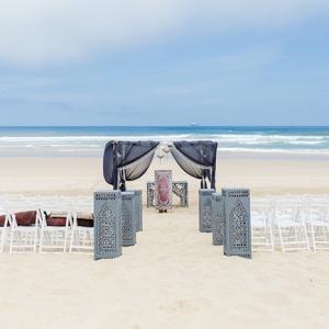 Boho beach wedding ceremony area