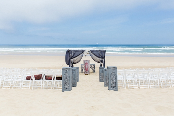 Boho beach wedding ceremony area