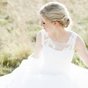 Bride in illusion neckline wedding dress