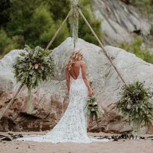 Bride with Boho Triangle Tipi Ceremony Arch