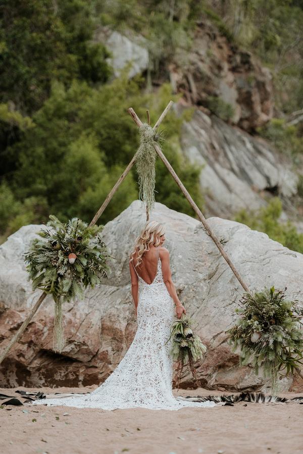 Bride with Boho Triangle Tipi Ceremony Arch