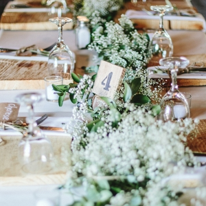 Rustic table with greenery runner