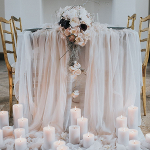 Table with Silk Linens and Candle Arrangement