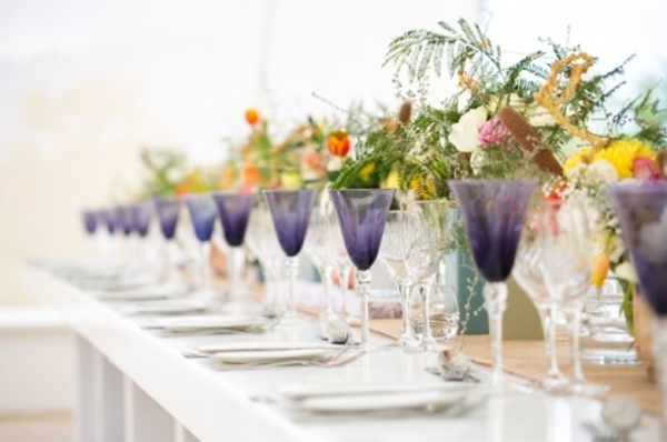 Tablescape with colorful glassware