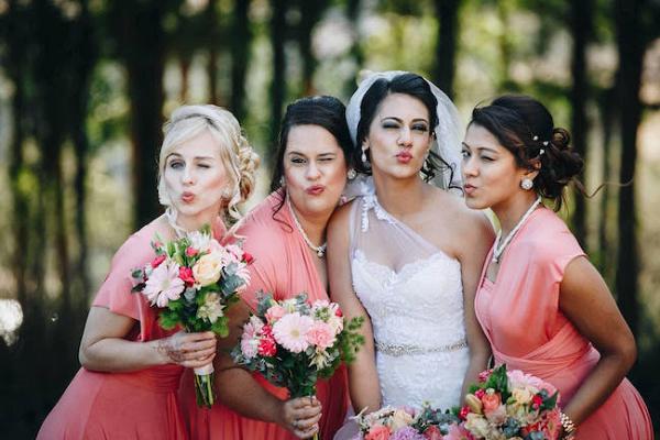 Bridesmaids in Coral Dresses