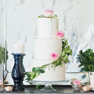 White Cake with Rose Decorations