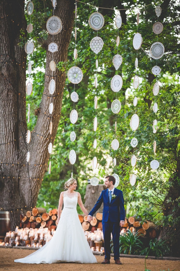Bride and groom with crochet dreamcatcher backdrop