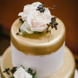 Gold wedding cake with berries