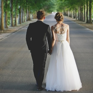 Bride and groom on leaf avenue