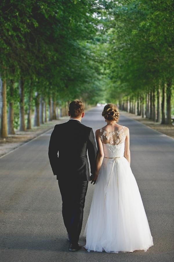 Bride and groom on leaf avenue
