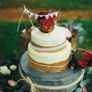 Rustic wedding cake with proteas
