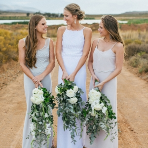 Bride & bridesmaids with oversize bouquets
