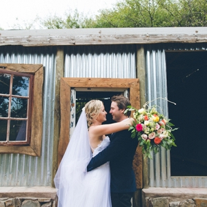 Bride & Groom at Farm Building