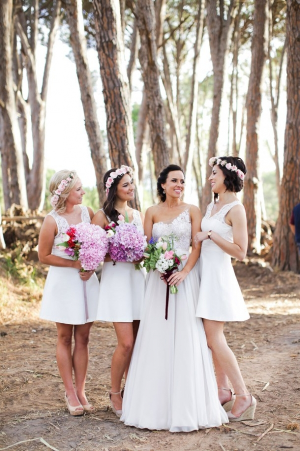 Bridesmaids with colorful bouquets