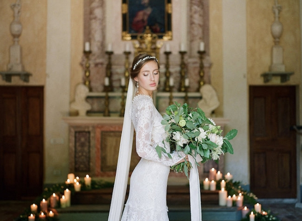 Bride with Greenery Bouquet in Candlelit Church