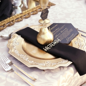 Opulent gold and black place setting