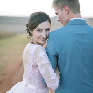 Bride in Pastel Lace Sleeve Wedding Gown