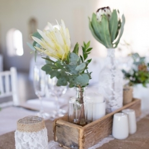 Rustic centerpiece with proteas and lace
