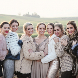 Mismatched Bridesmaids in Faux Fur Coats