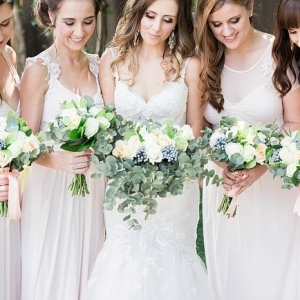 Bridesmaids in long white dresses