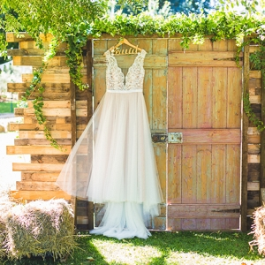 Lace Wedding Dress on Wooden Door