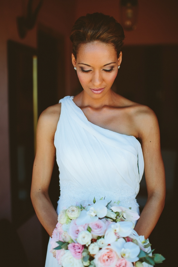 Bride in one shoulder wedding dress