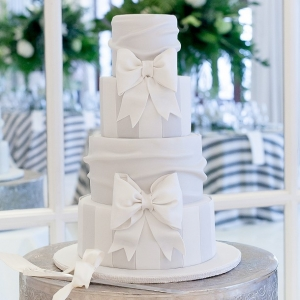 Stripes and bows wedding cake