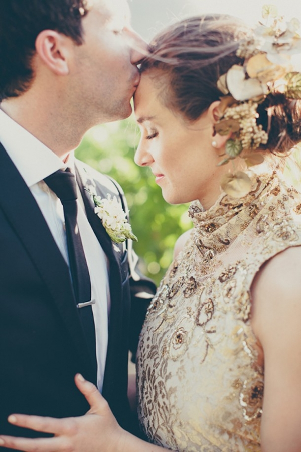 Groom and bride in gold dress
