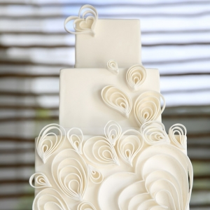 White wedding cake with curl hearts