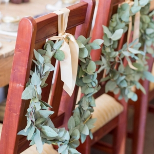 Greenery chair wreaths