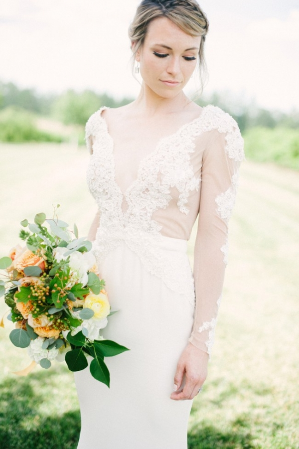 Bride in lace sleeve dress