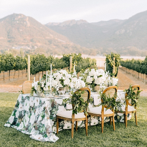 Green and white floral wedding table design