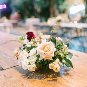 Blush and burgundy floral wedding centerpiece