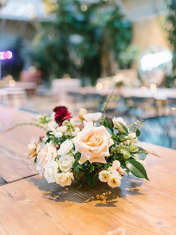 Blush and burgundy floral wedding centerpiece