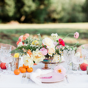 Colorful citrus wedding tablescape