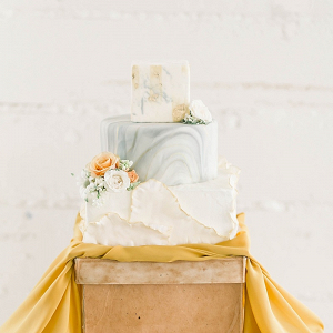 Textured gray and yellow marble wedding cake