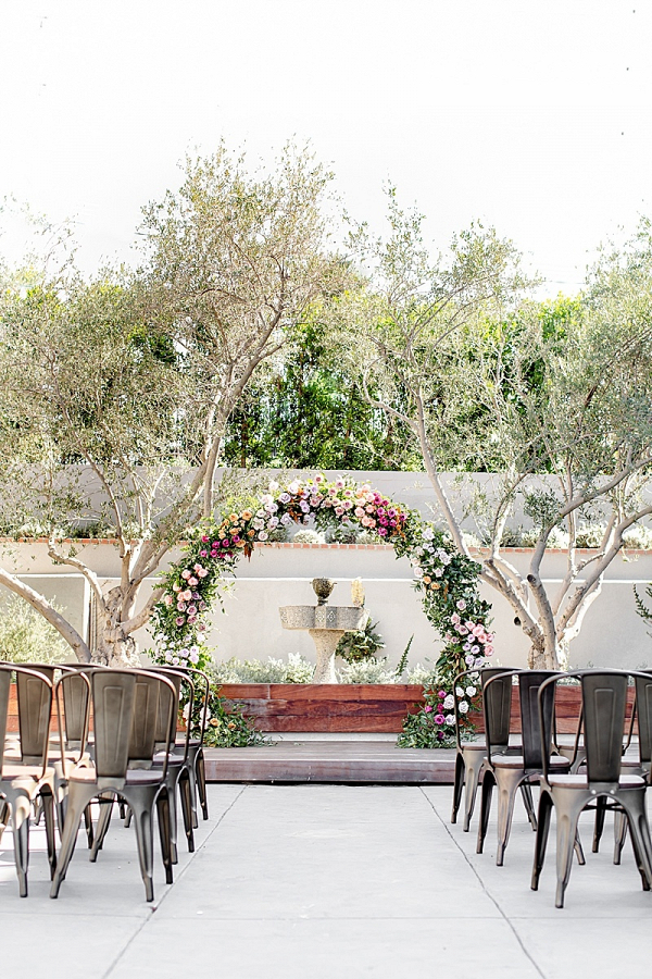 Round floral ceremony arch
