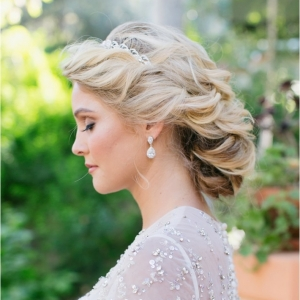 Elegant and Classic Bride in a beaded wedding gown and a curled bridal updo.