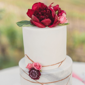 Marble wedding cake with peony topper
