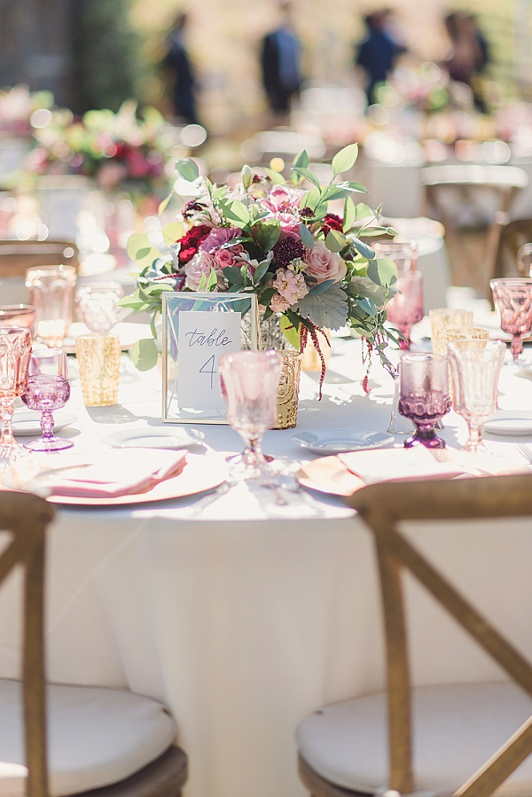Elegant pink and burgundy ranch wedding table