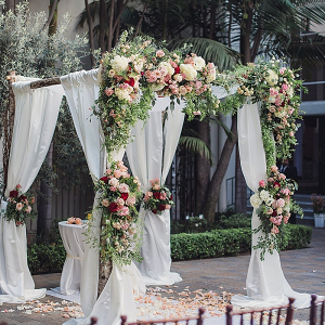 Draping and floral covered ceremony arbor