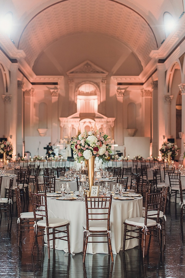 Elegant wedding reception with tall floral centerpieces