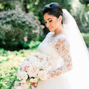 Elegant bride in long sleeve lace gown