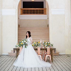 Bride in tulle and lace gown with modern copper wedding table