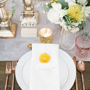 Modern yellow and copper place setting
