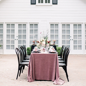 Modern elegant wedding table with velvet tablecloth