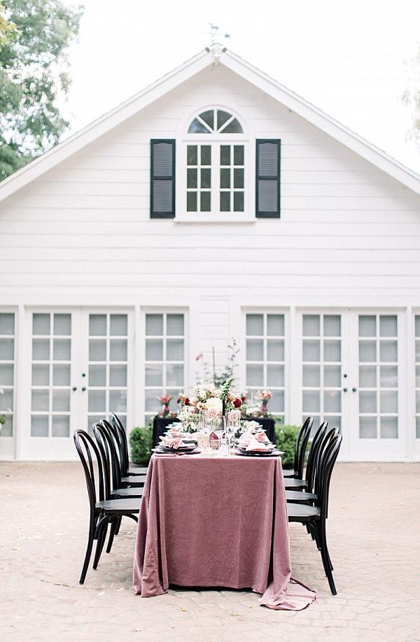 Modern elegant wedding table with velvet tablecloth