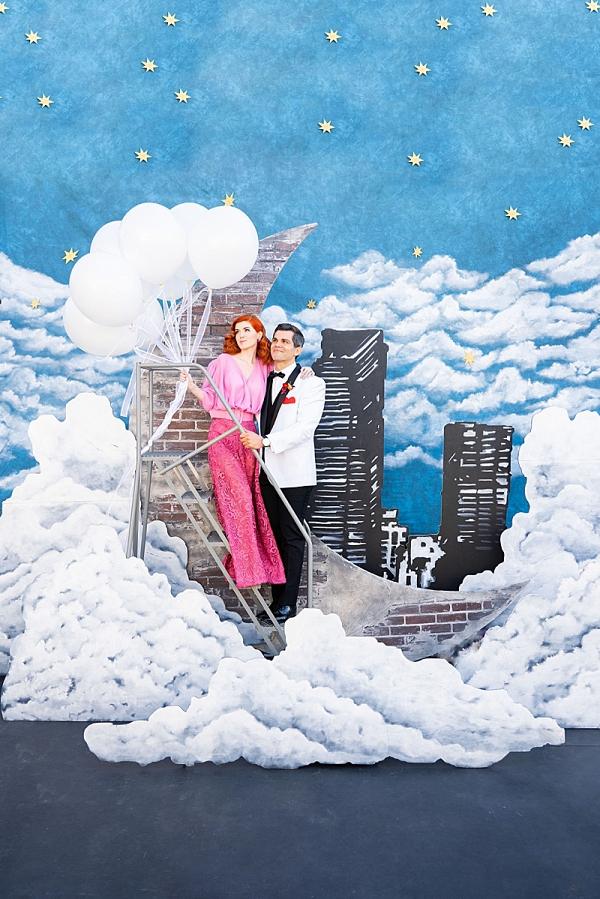 Retro moon backdrop with cityscape