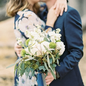 Engaged Couple holding bouquet